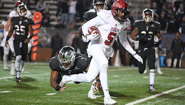 Arkansas State running back Daryl Rollins-Davis (5) runs pas Troy safety Kris Weatherspoon (3) for a 6-yard touchdown run during the second half of an NCAA college football game in Troy, Ala., Thursday, Nov. 17, 2016. Arkansas State won 35-3. (Photo/Thomas Graning)