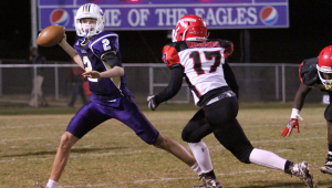 Messenger Photo/dan smith Goshen junior quarterback Brock Snyder passes against Southern Choctaw Friday night as Ka'Vonte Howard applies pressure. The Eagles fell to the Indians 34-14.