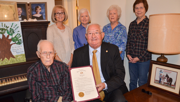 John Virgil Botts of the Enon community received a proclamation from the Alabama Legislature Saturday honoring him on his 100th birthday. State Rep. Alan Boothe presented the proclamation to Botts at a birthday celebration at his home. Pictured at the presentation are Botts, Boothe and Botts' daughters, Rosemary Leggett, Kathie Brown, Barbara Norwood and Brenda Riley.