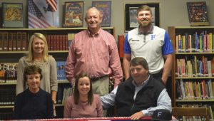Pike Liberal Arts golfer Susie Stell signed a scholarship on Tuesday morning to play golf at Faulkner University in Montgomery. She was joined in the library by friends, coaches and fellow students.