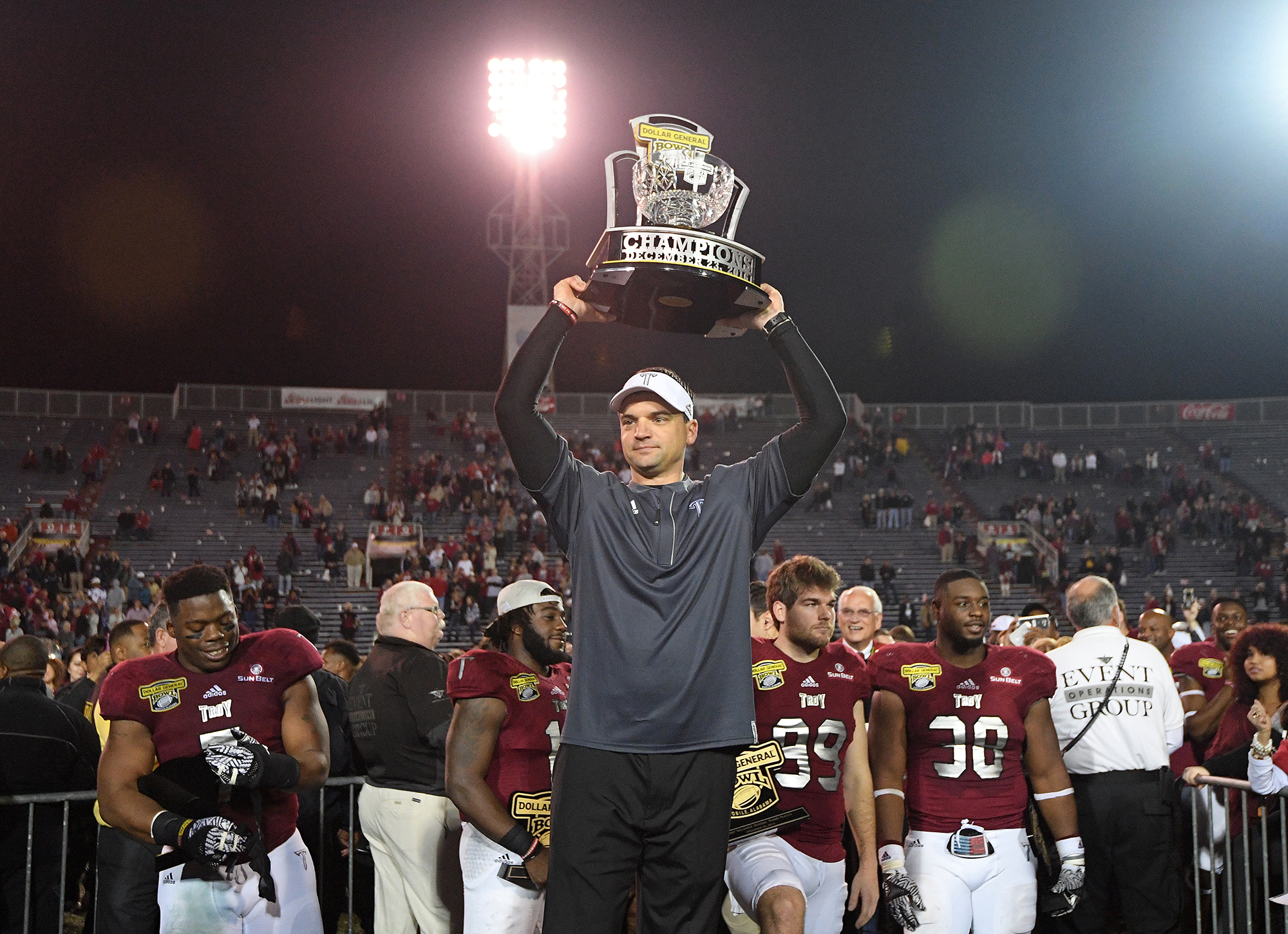 Troy head coach Neal Brown lifts the Champions Trophy after the Dollar General Bowl NCAA college football game against Ohio in Mobile, Ala., Friday, Dec. 23, 2016. Troy won 28-23. (Photo/Thomas Graning)