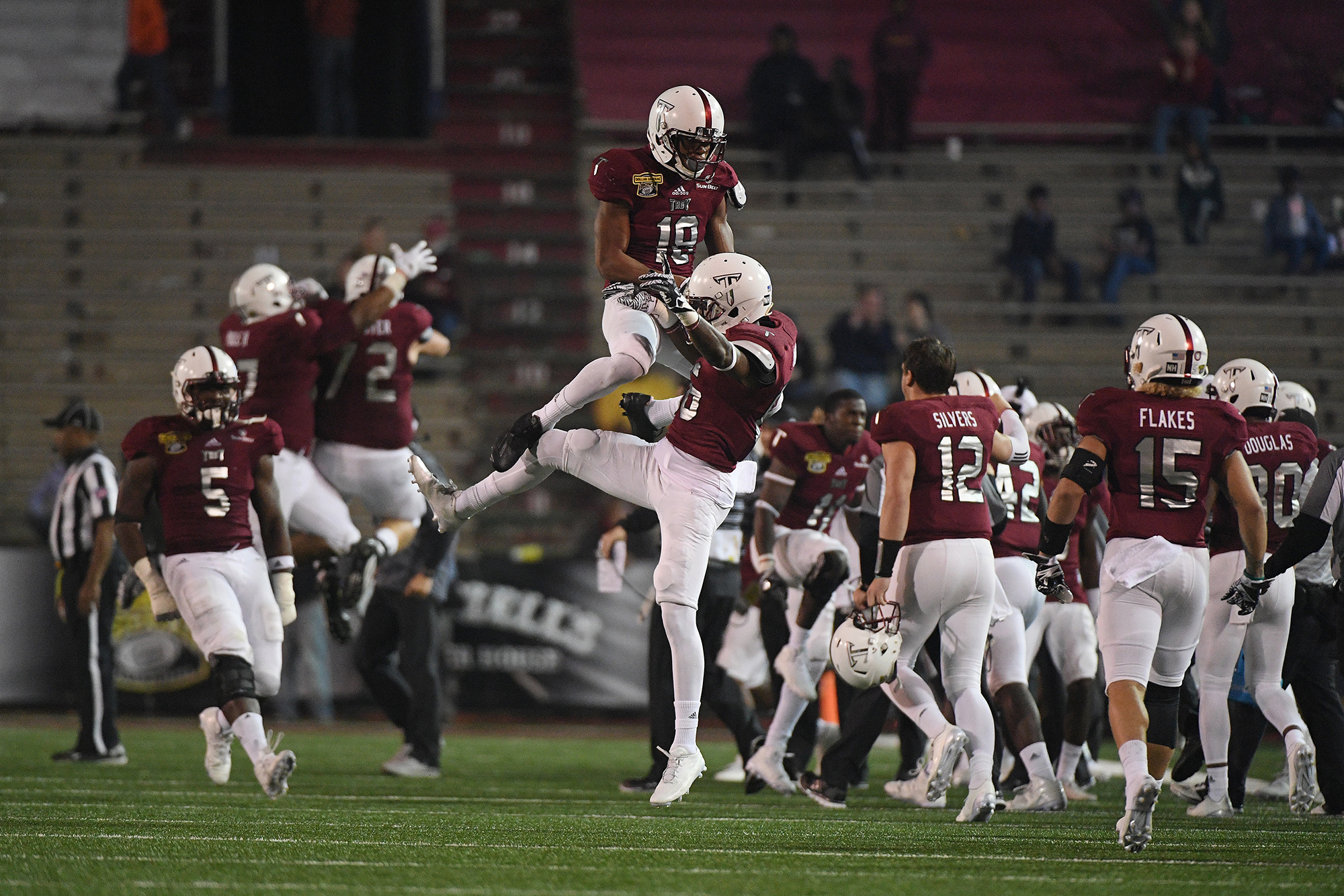 Troy cornerback Blace Brown (18) and wide receiver Justin Wyatt (86) celebrate after a missed Ohio during the second half of the Dollar General Bowl NCAA college football game in Mobile, Ala., Friday, Dec. 23, 2016. Troy won 28-23. (Photo/Thomas Graning)