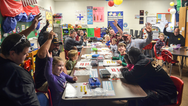 "Banks School hosted ""Dads Do Math Day"" Thursday with more than 80 ""dads'"" participating. The event was designed to involve dads more in their children's education and to provide them with an opportunity to learn more about the way math is being taught."