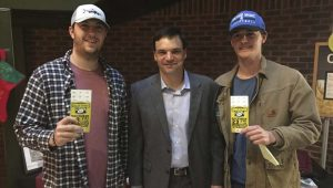 Photo/troy athletics Troy University students Nick Golden and Clayton Willis pose with Troy head football coach Neal Brown. Golden and Willis were the first students to claim their free Dollar General Bowl tickets when they got in line at 6:40 a.m.