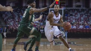 Photo/troy athletics The Trojans found themselves down by as many as 21 points on Thursday night against the South Florida Bulls. A strong second half comeback came up just short and the Trojans fell to the Bulls 80-74.