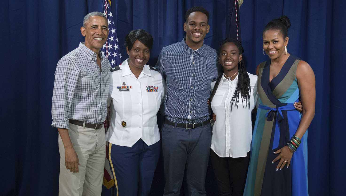 Brundidge native Lieutenant Colonel Letitia Bryant and her children were among 300 service members and their families who were selected to meet President Barak Obama and First Lady Michelle Obama on Christmas Day at Kaneohe Marine Corps Base in Hawaii. Pictured are President Obama, Lieutenant Colonel Letitia Bryant, Kendall Bryant, Kaelan Bryant and First Lady Michelle Obama. Inset below, Major Letitia Bryant with President Obama at Pentagon in January 2009. Photos courtesy White House Press Office.