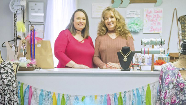 Messenger photo/Jonah Enfinger Debra Alton always dreamed of owning her own dress shop, and now that dream is a reality with her new boutique LaBella on South Brundidge Street. Alton (right) and her daughter Dawn Broderway (left) hope to make this their only full-time jobs after both have worked several jobs for years.