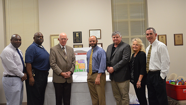 """Dr. Mark Bazzell, superintendent of Pike County Schools praised his board as """"the best in the state"""" at a reception in the board's honor Monday. The reception was held prior to the board's regular January meeting at the Pike County Board of Education Central Office and in conjunction with School Board Recognition Month. Pictured from left, board members, Dr. Clint Foster, Earnest Green, Wyman Botts, Dr. Greg Price, Bazzell, Linda Steed and Chris Wilkes."""