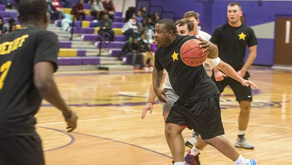 Deputies with the Pike County Sheriff's Office make a pass during a fundraiser basketball game at Goshen High School to raise funds for Goshen student Denver Buck, who was seriously injured in an accident the weekend before. Buck is still in a coma at Baptist South in Montgomery.