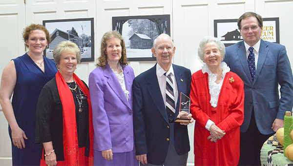 The Pioneer Museum of Alabama honored Donal Dunbar, one of its own, with the  2017 Curren Adams Farmer Outstanding Pioneer Achievement Award Saturday night at the museum's annual award dinner program. The award was presented to Dunbar by Jeff Kervin, board of directors chairman. Pictured, with Dunbar and his wife, Sarah Lee, are from left, Kari Barley, museum director, and daughters, Dorothy Rogers and Dianna Lee Dunbar, and Kervin.