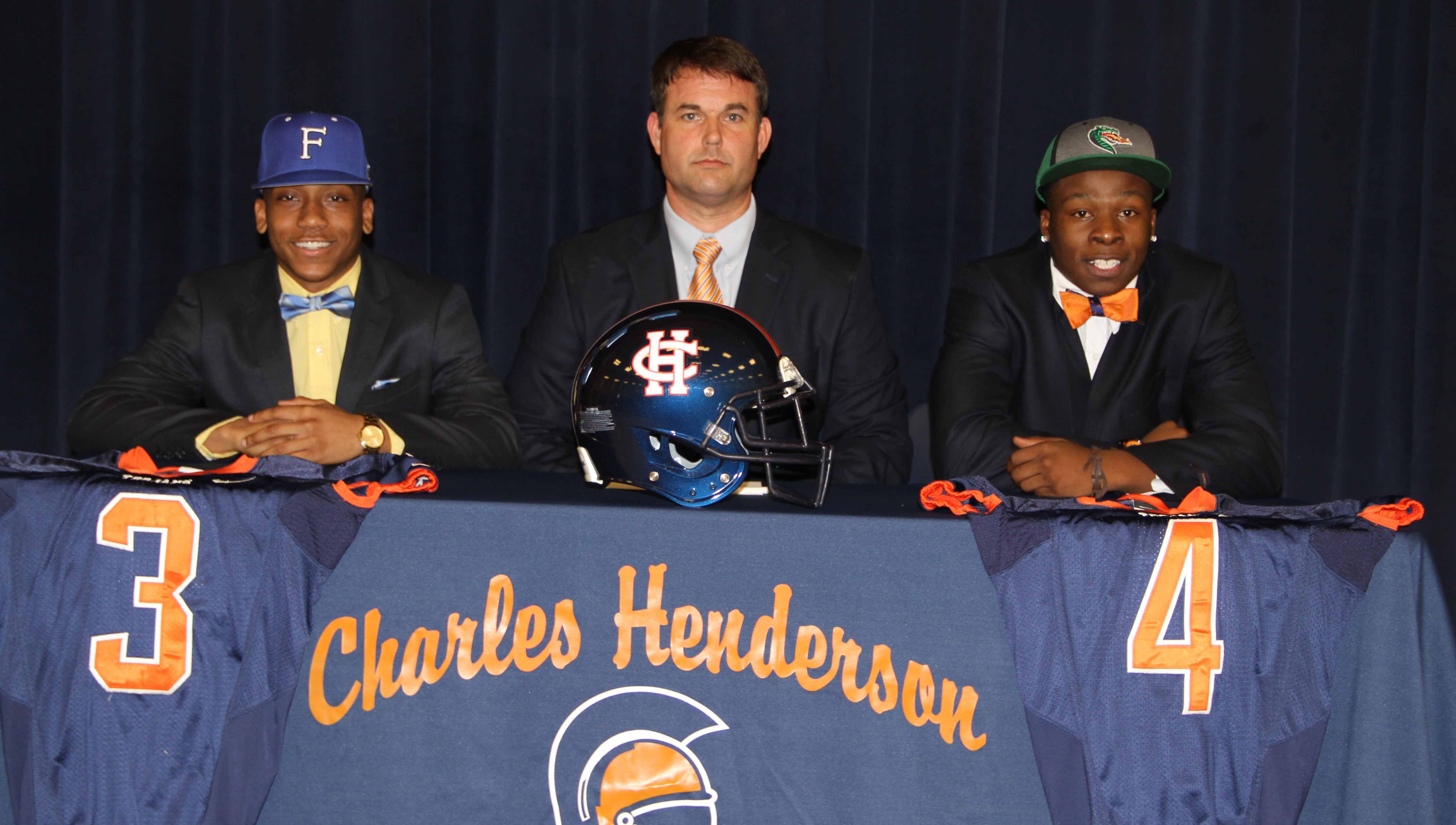 Photo/dan smith Jabronski Williams, CHHS Head Football Coach Brad McCoy and Kobe Griffin at National Signing Day Wednesday.